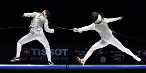 Italy's Valentina Vezzali (L) competes with Russia's Larisa Korobeynikova during the women's team foil final match at the European Fencing Championships in Montreux, Switzerland, on June 11, 2015. AFP PHOTO / FABRICE COFFRINI / AFP / FABRICE COFFRINI